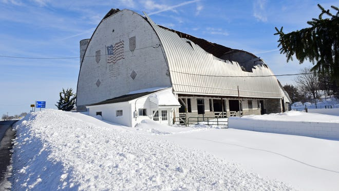 A barn, seen Monday,  Jan. 25, 2016, at Franklin County 4-H experienced a partial collapse sometime Sunday. Snow from winter storm Jonas collected on roofs around the region, causing some to collapse under the pressure.