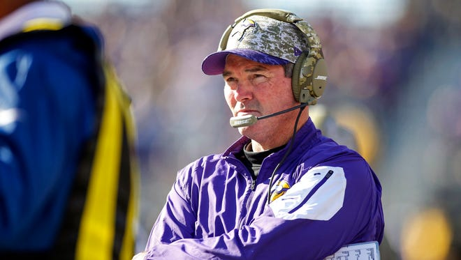 Minnesota Vikings head coach Mike Zimmer looks to the field as his team plays the St. Louis Rams at TCF Bank Stadium.