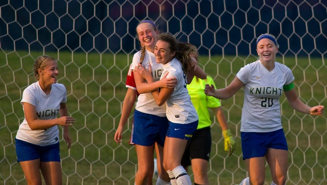 Castle's Lydia Young, second left, is congratulated by teammate Allie Buttry after she scored against Mater Dei during their game at Castle High School Thursday evening. Castle won 4-1.