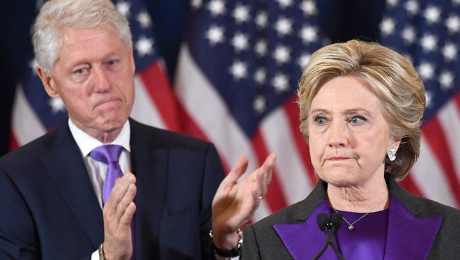 US Democratic presidential candidate Hillary Clinton makes a concession speech after being defeated by Republican President-elect Donald Trump, as former President Bill Clinton looks on in New York on November 9, 2016.