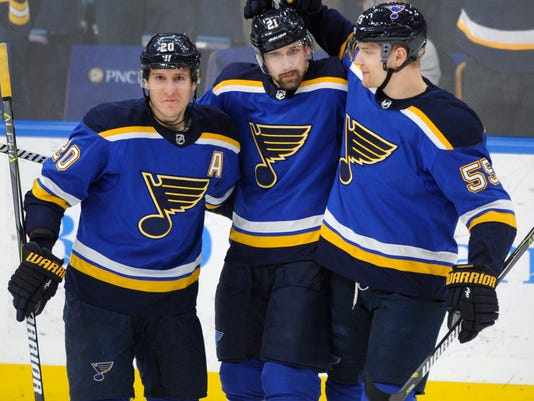 St. Louis Blues' Patrik Berglund (21), of Sweden, is congratulated by Alexander Steen (20) and Colton Parayko (55) after his goal against the Vancouver Canucks during the first period of an NHL hockey game, Friday, March 23, 2018, in St. Louis. (AP Photo/Bill Boyce)