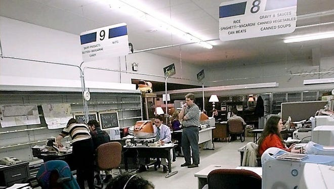 Leaf-Chronicle employees work in the grocery store turned newsroom in Clarksville, on Feb. 15, 1999, in the wake of the January tornado. Seated in the background are Richard Stevens and Chris Smith, conducting their second hiring interview.