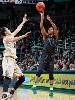 Michigan State's Branndais Agee, right, shoots a 3-pointer against Purdue's Dominique McBryde Sunday, Jan. 22, 2017, in East Lansing, Mich. Michigan State fell 76-66.