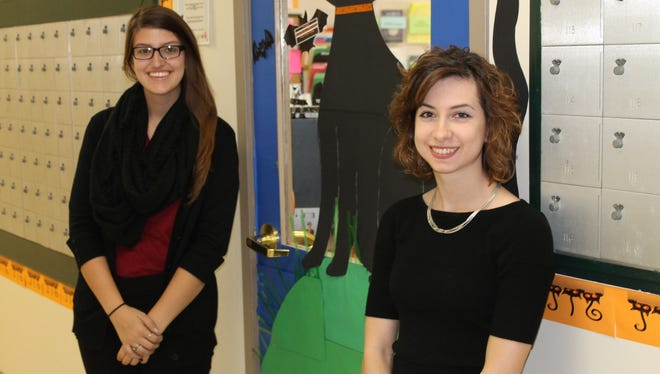 Shania Logan, left, and Emily Ross took a decorative approach to helping area families. The effort is just one way Ohio University-Chillicothe students are giving back to the community.