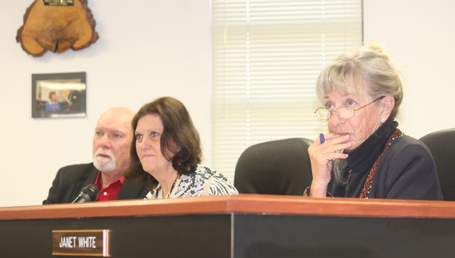 Otero County Commissioners Ronny Rardin, Susan Flores and Janet White listen to Fair Board Vice-Chairman Matt Nix speak about gun shows being held at the Otero County Fair and Rodeo Fairgrounds at the county commission meeting Jan. 14.