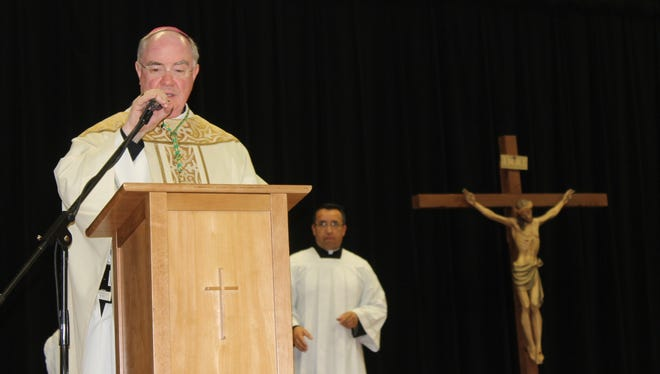Bishop Michael Mulvey reflects on St. John Paul II High School's 10th anniversary during a Mass in the school's cafeteria.
