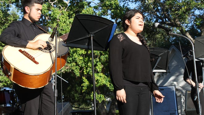 Moody High School's mariachi band performs at the Westside Business Association's Cinco de Mayor celebration.