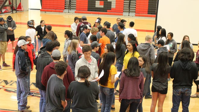 """Youths mingle at a """"Connecting Cultures for YOUNITY"""" conference last week in Browning."""