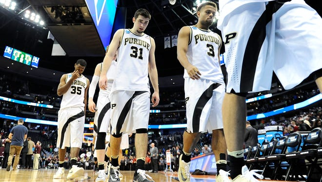 Mar 17, 2016; Denver , CO, USA; Purdue Boilermakers players leave the court after loosing to Arkansas Little Rock Trojans 85-83 during Purdue vs Arkansas Little Rock in the first round of the 2016 NCAA Tournament at Pepsi Center. Mandatory Credit: Ron Chenoy-USA TODAY Sports