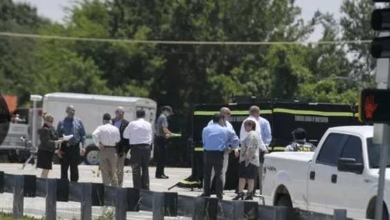 Law enforcement personnel investigate an officer-involved shooting Tuesday on the Peytsonsville Road overpass over Interstate 65.