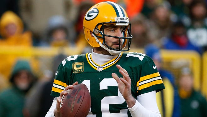 Green Bay Packers quarterback Aaron Rodgers (12) looks for a receiver during the first half of an NFC wild-card NFL football game against the New York Giants, Sunday, Jan. 8, 2017, in Green Bay, Wis. (AP Photo/Mike Roemer)