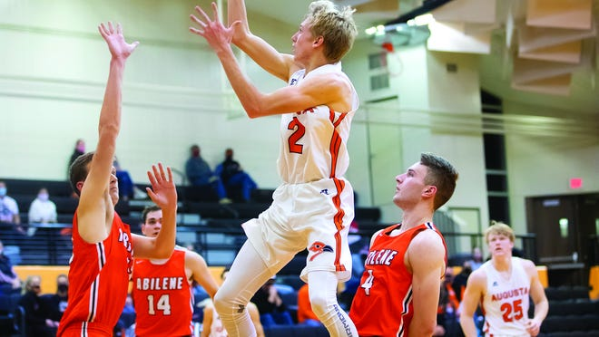 Augusta's Brendan Parker (2) goes up for a shot against Abilene on Friday, Dec. 11 at Augusta High School. He scored 12 points in the 56-53 loss to the Cowboys.