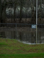 Standing floodwater continue to cover parts of the outfield at Burdette Park's baseball fields Tuesday afternoon.