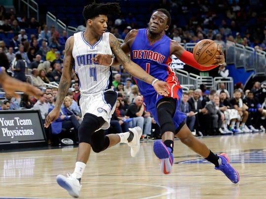 Magic guard Elfrid Payton (4) tries to slow down Pistons