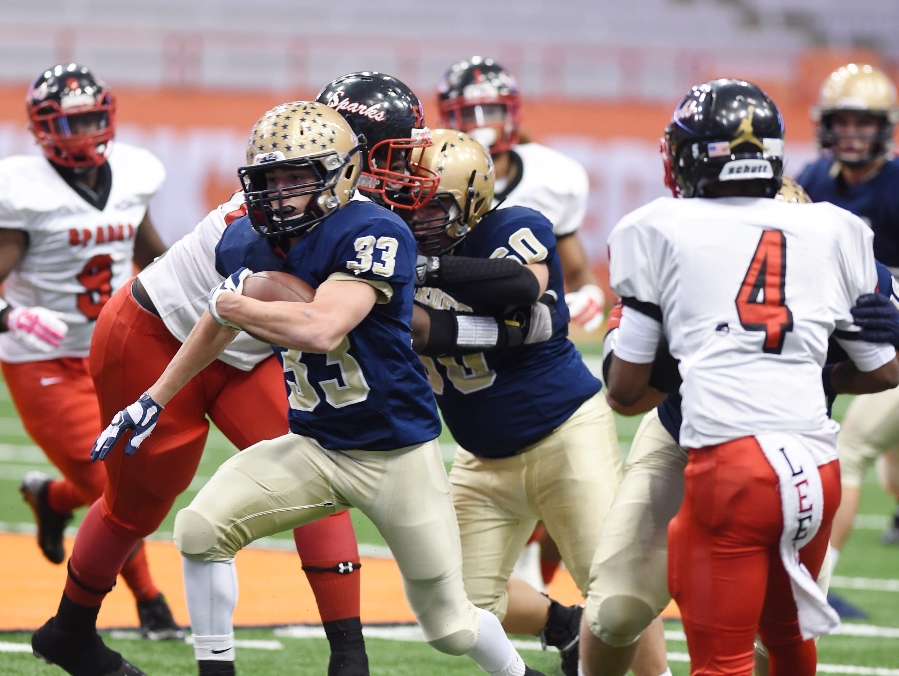 Our Lady of Lourdes High School's Joe Scaglione carries the ball through the South Park defense during the Class A New York State championship in Syracuse on Nov. 27, 2015.