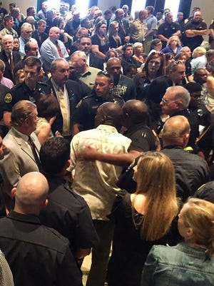 People crowd to attend the memorial service for the fallen HPD officers today at the Lake Terrace Convention Center.