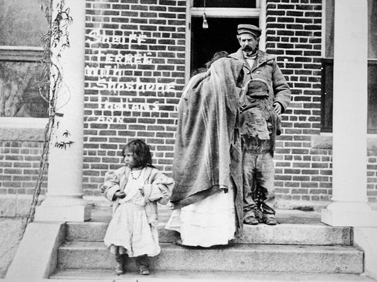 Washoe County Sheriff Charles P. Ferrell and the four Indian captives of the Shoshone Mike battle are shown at the Reno jail in 1911. A baby is hidden under the blanket worn by the teenage girl in the center. A boy stands at right.