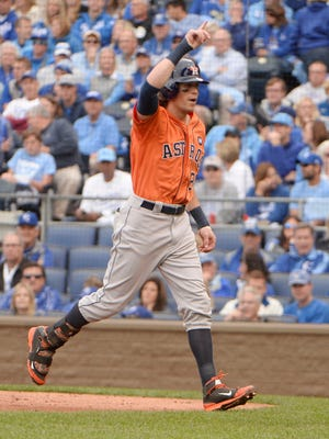 Houston Astros left fielder Colby Rasmus reacts after hitting a solo home run against the Kansas City Royals in the third inning in game two of the ALDS.
