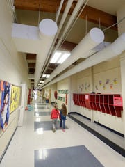 Students walk in the older portion of Oostburg Elementary