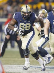 T.J. Clemnings of Pitt began his career as a defensive end but switched to offensive tackle as a junior.