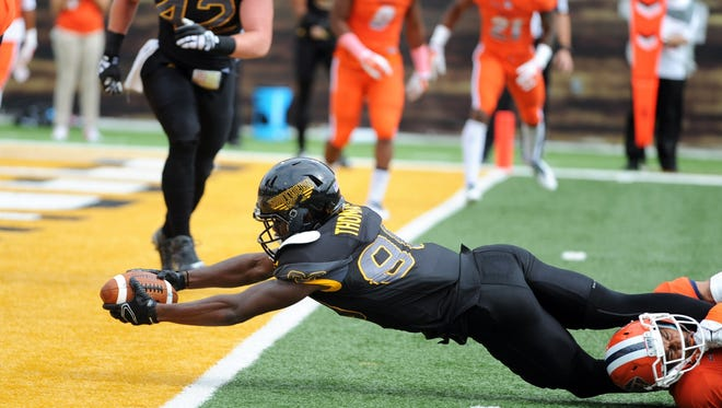 Southern Miss player Mike Thomas stretches for a touchdown against UTEP earlier this season. Southern Miss is 7-3 after winning four games the last three seasons combined.