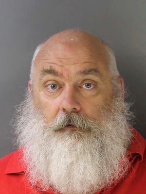 "This photo provided by the Delaware County District Attorney's Office in Media, Pa., shows William T. McKinlay, arraigned Thursday, June 22, 2017, on felony charges including attempted statutory sexual assault and solicitation and attempted involuntary indecent sexual intercourse. Prosecutors say McKinlay, a seasonal employee at a Macy's department store in Philadelphia, referred to himself as ""dirty old Santa"" and traveled to the Philadelphia suburb of Folsom, Pa., to have a sexual tryst with a 14-year-old girl he lured online, although the girl was actually a law enforcement officer working a sting operation. The Delaware County Daily Times reports McKinlay's Facebook page shows a photo of him dressed as Santa dated December 2016. (Delaware County District Attorney's Office via AP)"