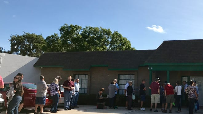 People lined up outside Trulieve, the Treasure Coast's first medical marijuana dispensary, Thursday morning.