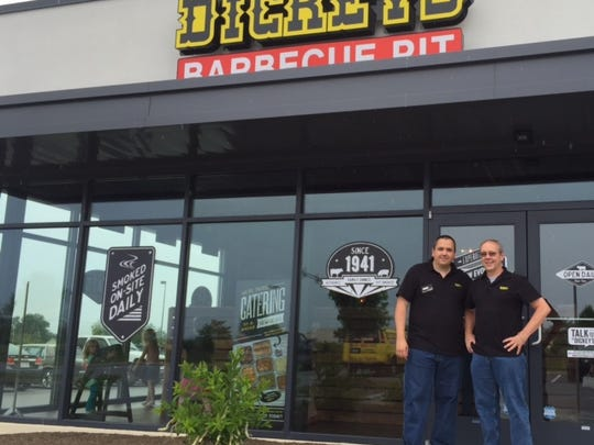 Franchisees Dennis Dacheux Jr. (left) and Dennis Dacheux Sr. stand in front of their Dickey's Barbecue Pit in Hanover.