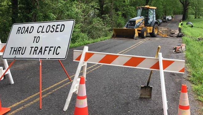 Horn Tavern Road in Fairview was temporarily closed over the weekend due to heavy rains destabilizing the road's foundation. Crews worked Monday afternoon to replace a culvert.