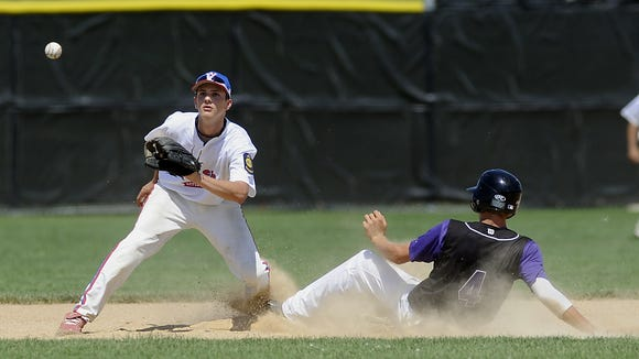 Apple Valley's Noah Seburg goes for the catch as Sioux Falls Post 15 East's Connor Schaefbauer slides into second Sunday at Harmodon Park, July 17, 2011. Schaefbauer will be back in South Dakota on Tuesday with the Minnesota Golden Gophers to face SDSU. (Elisha Page/Argus Leader)
