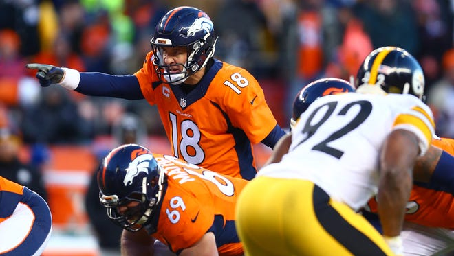 Denver Broncos quarterback Peyton Manning (18) reacts as he calls a play against the Pittsburgh Steelers during the AFC Divisional round playoff game at Sports Authority Field at Mile High.