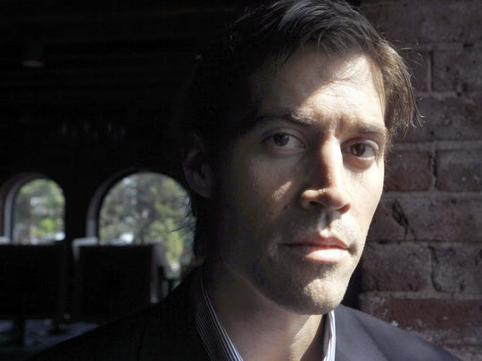 American journalist James Foley, of Rochester, N.H., poses for a photo in Boston. Jake Zelinski has been named Aug. 19, 2015, the first recipient of a scholarship named for journalist Foley, who was kidnapped in Syria and later beheaded by Islamic State militants.