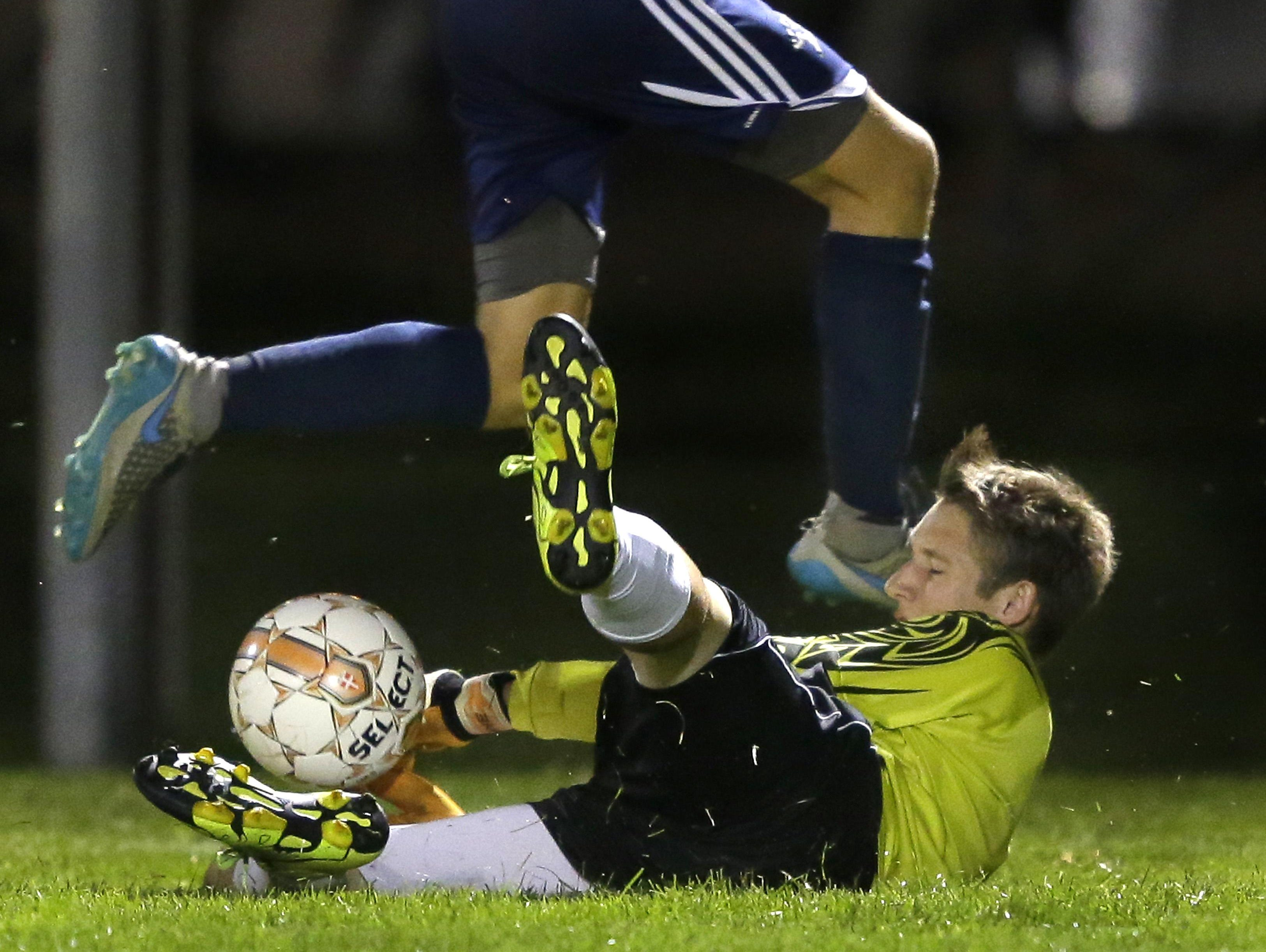 Appleton North's Osman Bajraktarevic leaps over Appleton West goalie Bryant Schisel during their Fox Valley Association soccer game Tuesday at Nienhaus Sports Complex.