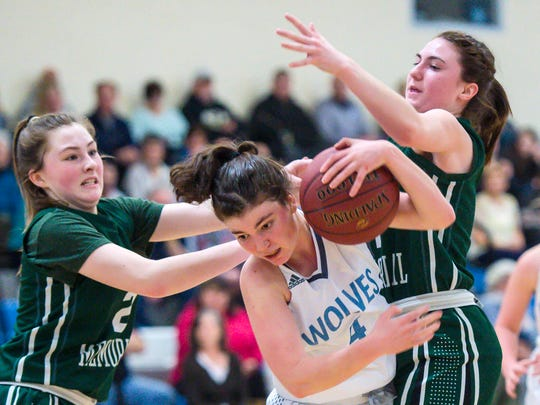 South Burlington's Joan Vera, center, contests the ball against Rice Memorial's Fiona Connolly, left, and Kristen Varin in South Burlington on Thursday, March 2, 2018.