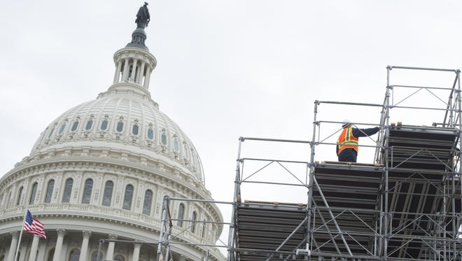 Workers build portions of the inaugural platform for the Presidential Inauguration of Donald Trump at the U.S. Capitol in Washington, DC.