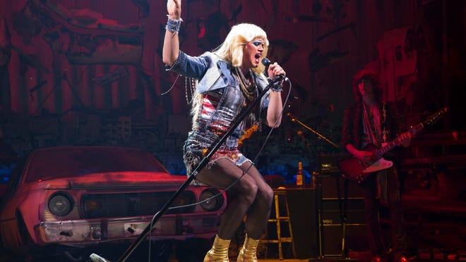 """This image released by Boneau/Bryan-Brown shows Andrew Rannells during a performance of """"Hedwig & the Angry Inch,"""" in New York."""
