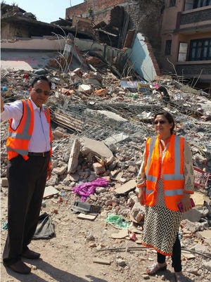 Satish Mehtani (left) with Dr. Rekha Chetry during their visit in May to a village near Kathmandu.