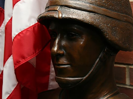 A bust of Marine Capt. Brent Morel, a 1999 graduate of the University of Tennessee at Martin, stands in the university's Paul Meek Library.