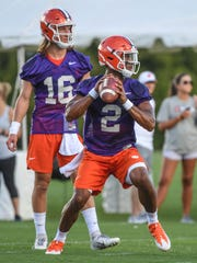 Clemson quarterback Kelly Bryant (2) passes near quarterback Trevor Lawrence (16) during the first day of practice at the Clemson Indoor Football facility at Clemson on Friday, August 3, 2018.