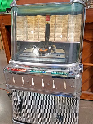 (feel free to edit).  This  vintage Ami Model Jai-200 jukebox recently sold at auction for $4,425.