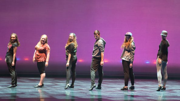 Kyle Laing, center, a sophomore musical theater major,