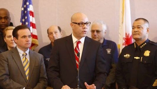 City Manager Harry Black (center) discussed reduced violent-crime rates at a press conference with Mayor John Cranley (left) and Police Chief Jeffrey Blackwell on Jan 13.
