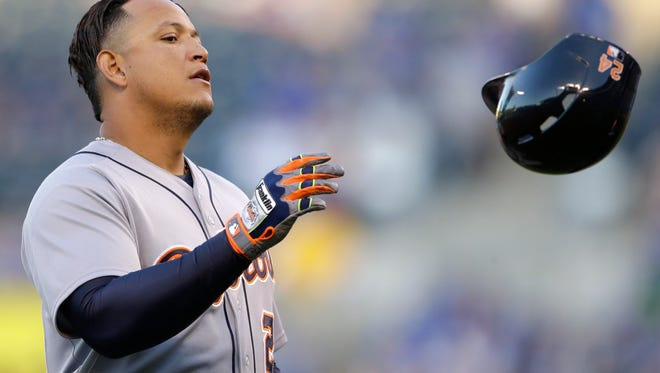 Detroit Tigers' Miguel Cabrera tosses his helmet after being left on base during the first inning a baseball game against the Kansas City Royals at Kauffman Stadium in Kansas City, Mo., Thursday, April 30, 2015.