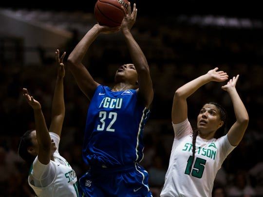 FGCU's Rosemarie Julien (32) shoots over two Stetson defenders in the second half of action during the Atlantic Sun championship game at the Edmunds Center Sunday, March 12, 2017 in DeLand, Fla. FGCU would win 77-70 to take home the tournament title and an automatic berth to the NCAA tournament.