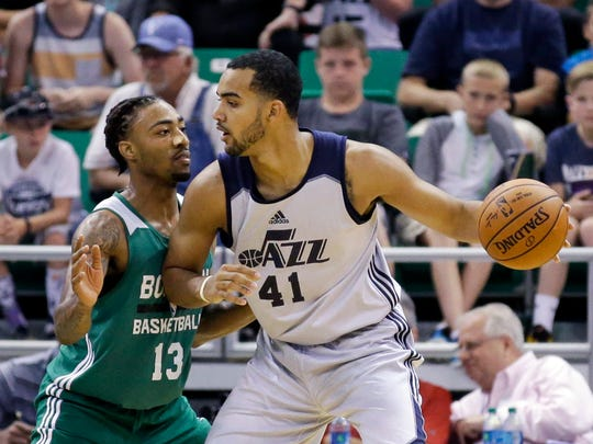 Boston Celtics' James Young (13) defends Utah Jazz's Trey Lyles (41) during the first half of an NBA summer league basketball game Tuesday, July 5, 2016, in Salt Lake City.