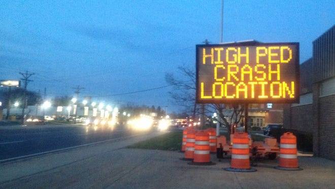 Signs on Kirkwood Highway warn motorists and walkers alike that the busy roadway is a high-crash area for pedestrians.