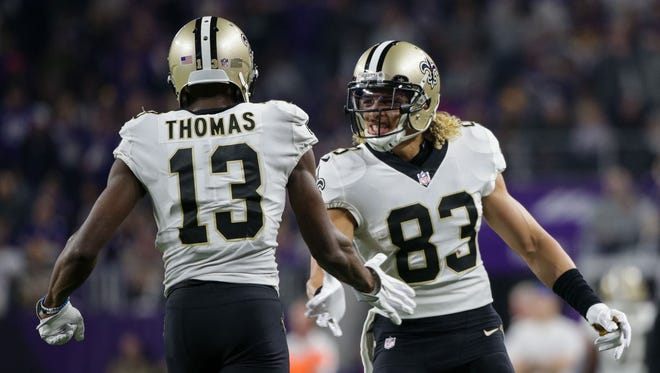 New Orleans Saints wide receiver Willie Snead (83) congratulates wide receiver Michael Thomas (13) after scoring in the third quarter against the Minnesota Vikings on Jan. 14, 2018, at U.S. Bank Stadium.
