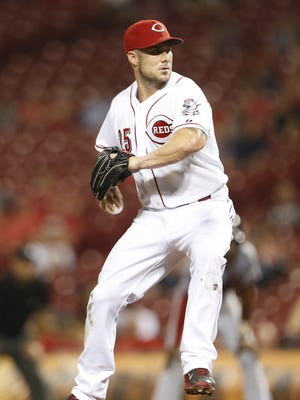 Cincinnati Reds Skip Schumaker (25) pitches during the ninth inning of their game against the Atlanta Braves played at Great American Ball Park in Cincinnati, Ohio Thursday.