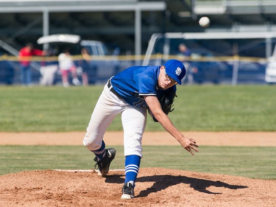 Decatur's Tristan McDonough (10) throws a pitch during