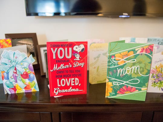 Mother's Day cards on the mantle inside Dorothy 'Taffy' Spera's home Friday, May 18, 2018 in Williamstown, N.J. Spera, a two-time breast cancer survivor, was nominated as an 'Amazing Mom' by her daughter. Spera was also the caregiver for her husband after a massive stroke left him paralyzed in 2003. He passed away in June.